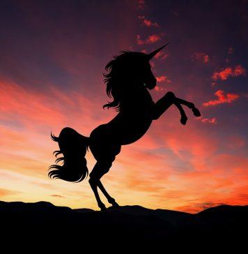 silhouette of a unicorn against twilight sky